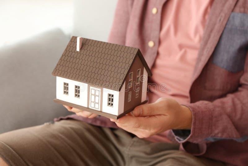 Man holding house model, closeup. Mortgage concept royalty free stock photos