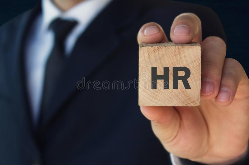 Man holding HR word on wooden cube stock photography