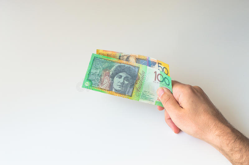 Man holding hundred and fifty Australian Dollar in his. Man holding hundred and fifty Australian Dollar banknote in his hands stock images