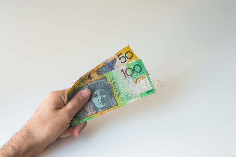 Man holding hundred and fifty Australian Dollar in his. Man holding hundred and fifty Australian Dollar banknote in his hands royalty free stock image