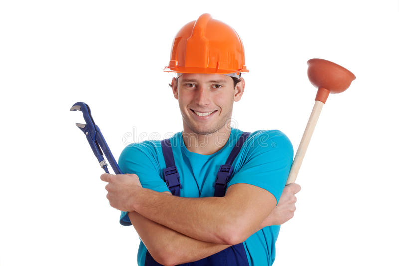 Man holding hydraulic tools. Man holding hydraulic wrench and a plunger royalty free stock photography