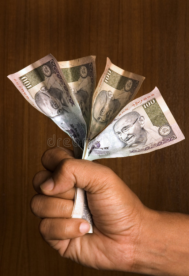 Man holding indian money royalty free stock photos