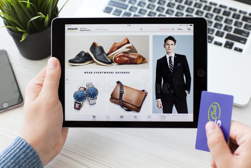 Man holding iPad Pro with Online shopping service Amazon stock image