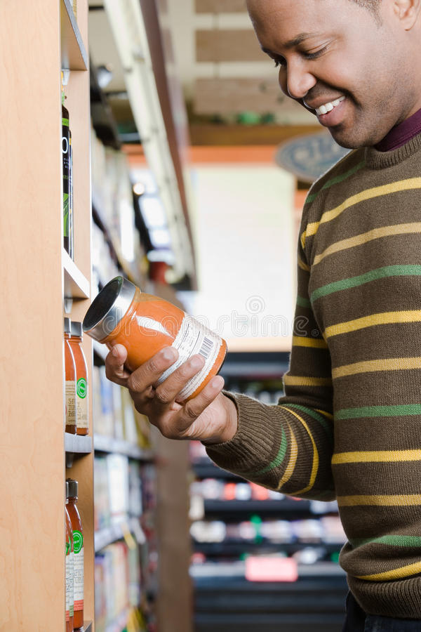 A man holding a jar. A men holding a jar royalty free stock images