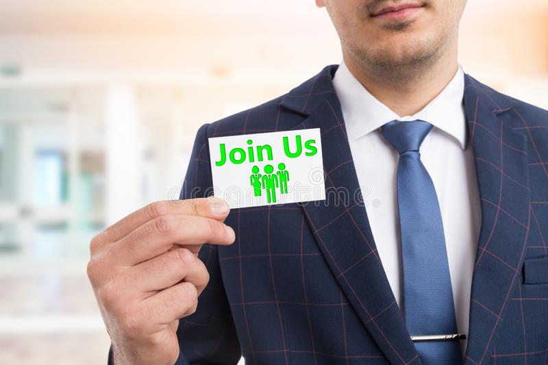Man holding join us card stock image