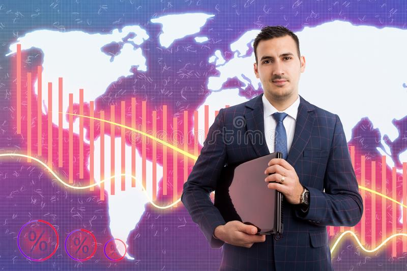 Man holding laptop on background with declining graph. Man working as broker at business stock market with serious expression holding laptop on background with stock photo