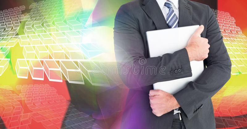 Man holding laptop with geometric transition. Digital composite of Man holding laptop with geometric transition royalty free stock photos