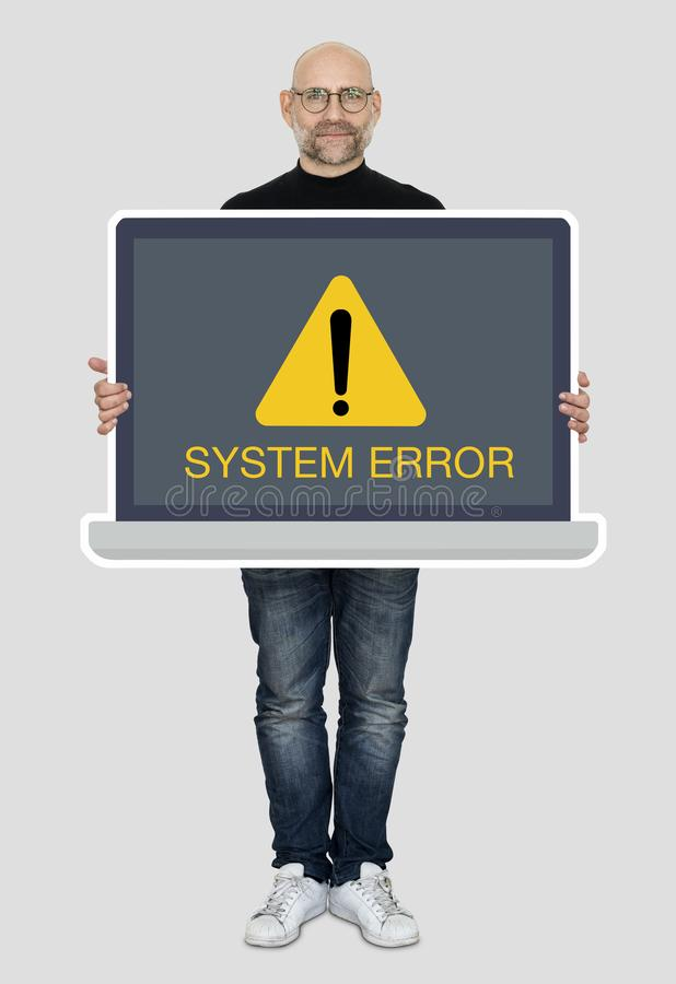 Man holding a laptop with a system error royalty free stock photos