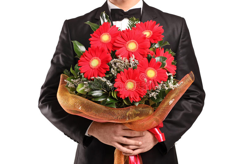 A Man Holding A Large Bouquet Of Flowers Stock Image - Image of ...