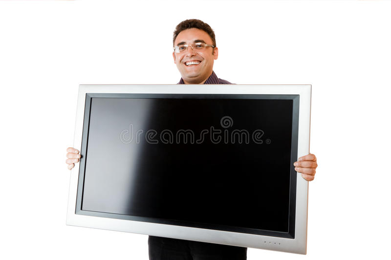 Man holding lcd tv. Man holding in hands lcd tv isolated over white background royalty free stock photo