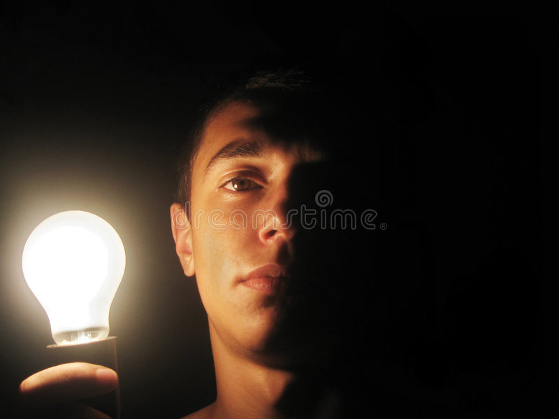 Download Man holding a lit bulb stock image. Image of invention - 4669779
