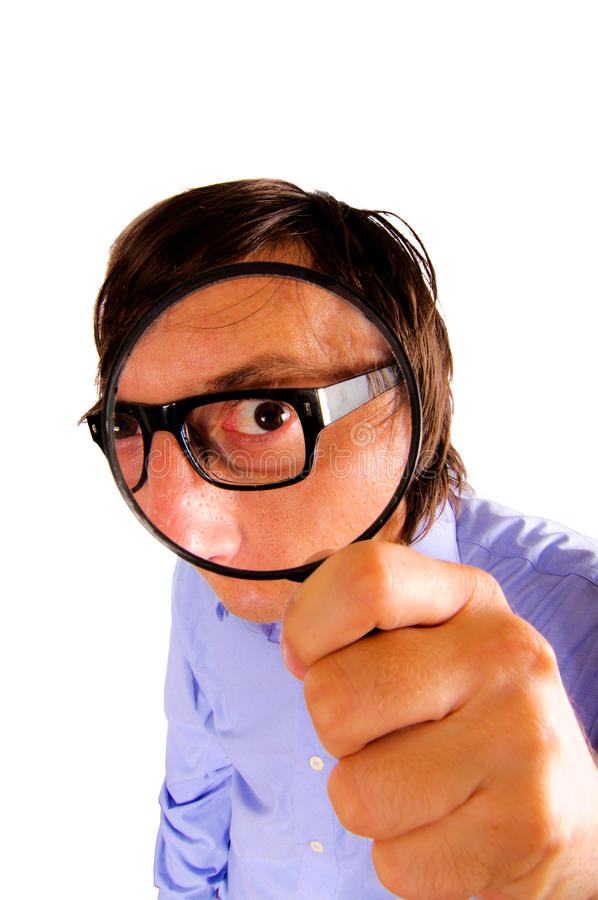 Man holding magnifying glass stock images