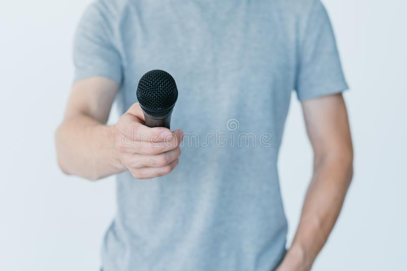 Man holding microphone interview broadcaster media. Man holding microphone conducting an interview. broadcaster recording information for mass media stock image