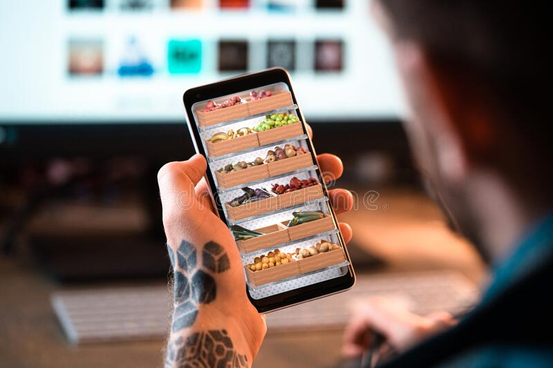 Man Holding Mobile Phone and Choosing Fresh Products Online in App. 3d Rendering royalty free stock photography