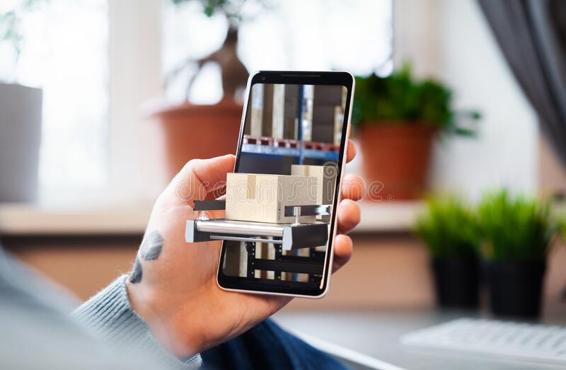 Man Holding Mobile Phone With Open App for Online Shopping and Delivery Directly From Warehouse or Factory. 3d Rendering royalty free stock image