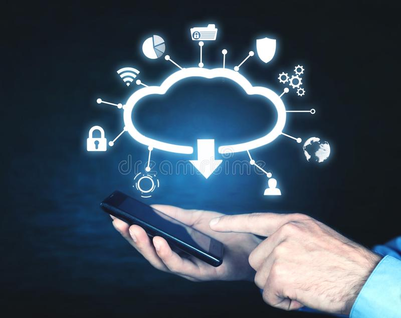Man holding mobile smartphone. Cloud download concept royalty free stock image