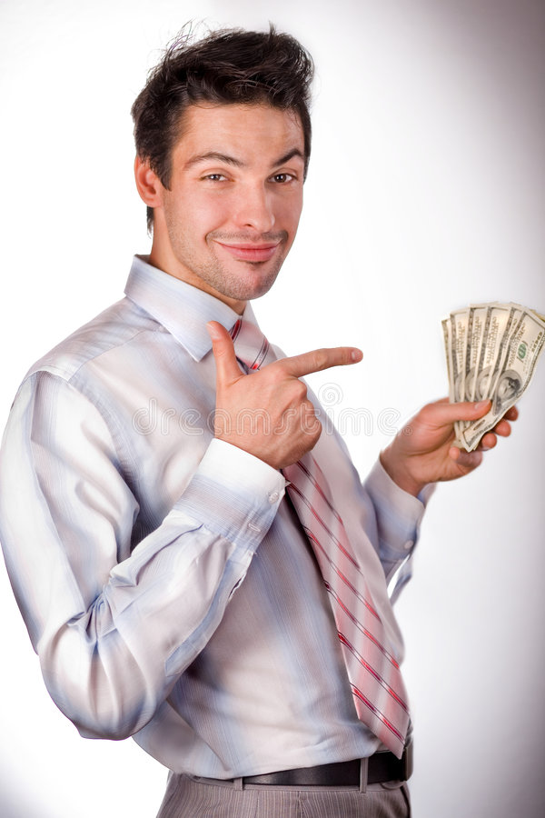 Man holding money. Man in a white shirt and a red tie on a white background. The businessman holds money in hands. Hands are lifted upwards and pressed to the royalty free stock image
