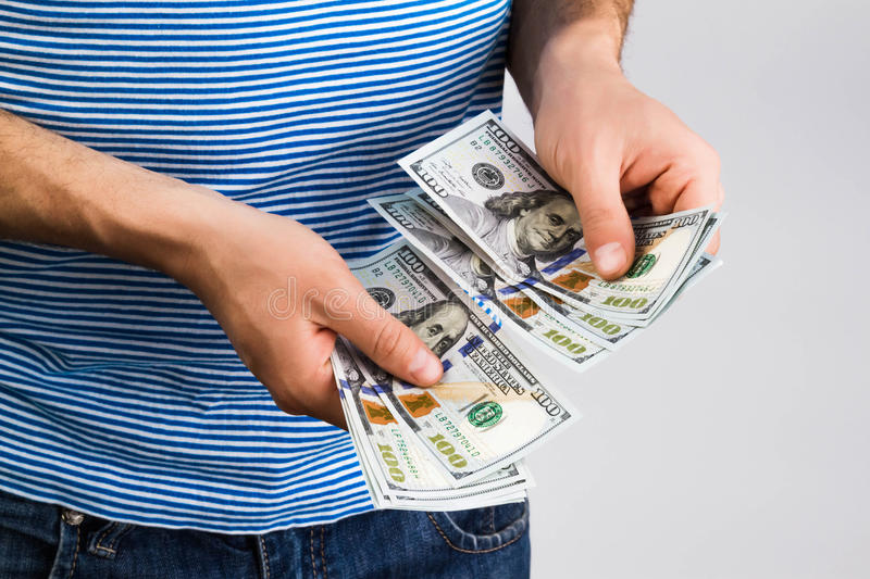 Man holding money in hand stock photography