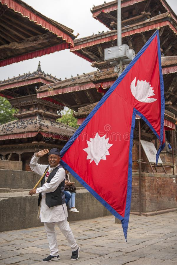 Man holding Nepalese Flag on Durbar square in Kathmandu. Nepal. Captured in May 2018 royalty free stock images