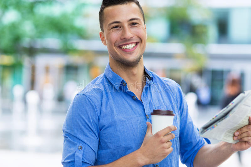 Man holding newspaper and coffee royalty free stock images