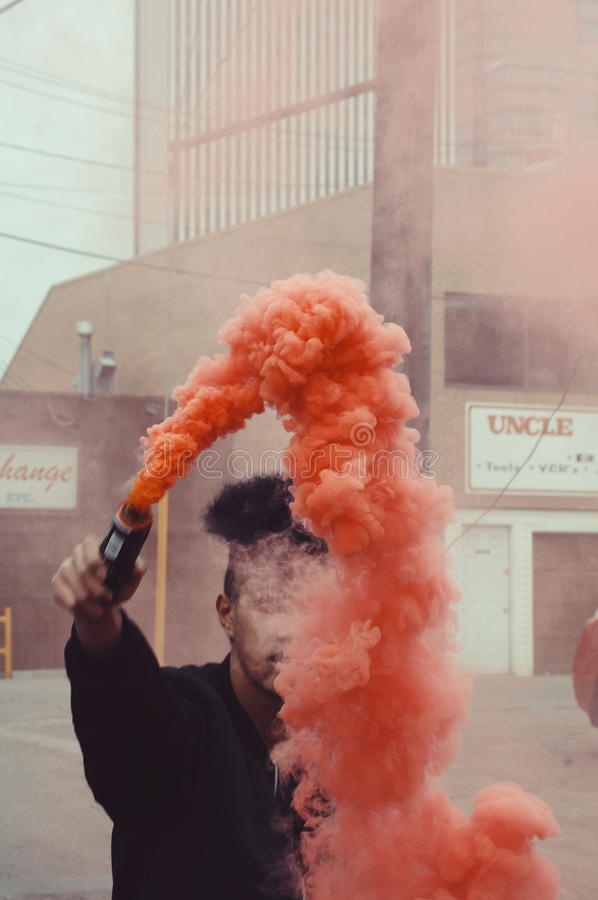 Man Holding Orange Smoke Free Public Domain Cc0 Image