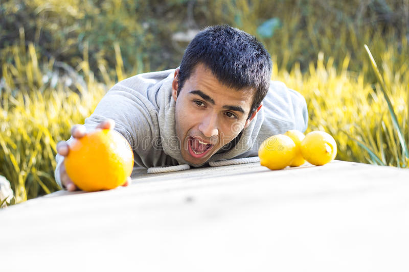 Man holding an orange royalty free stock images