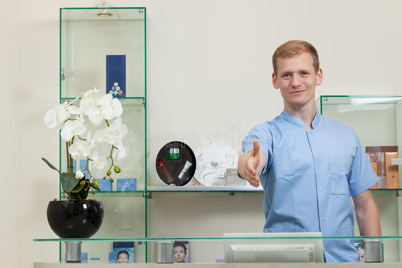 Man Holding Out Hand To Shake Hands At Beauty Salon Stock Photo