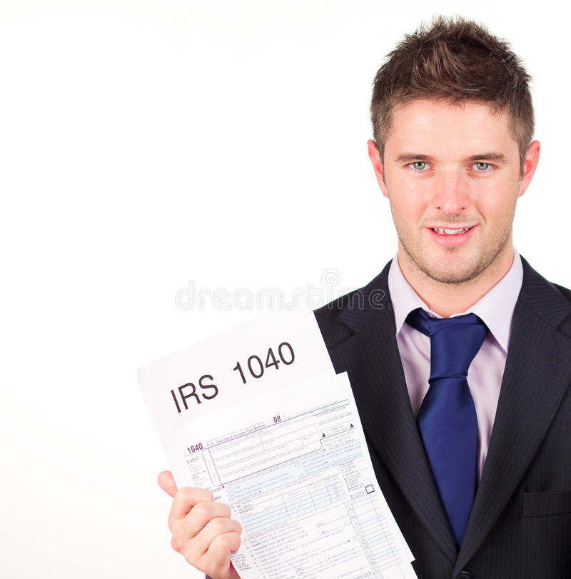 Download Man Holding Out His Irs Returns Form Stock Photo - Image: 10650332