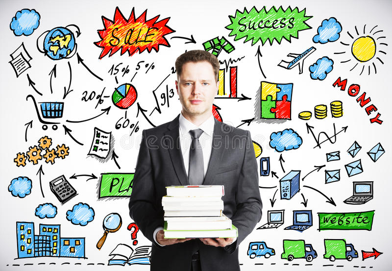 Man holding a pack of books with business strategy conce. Businessman holding a pack of books with business strategy concept on the background stock photos
