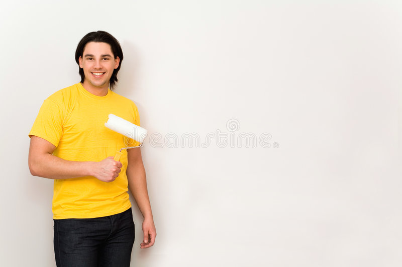 Man holding paint roller stock images
