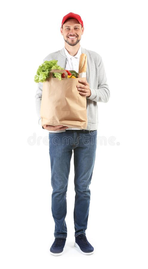Man holding paper bag with fresh products on white background. Food delivery service stock photos