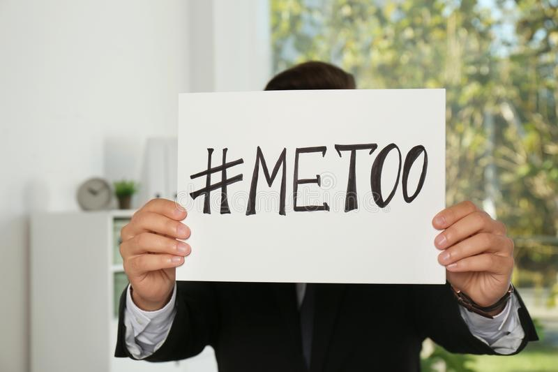 Man holding paper with text. ` METOO ` in office. Problem of sexual harassment at work stock images