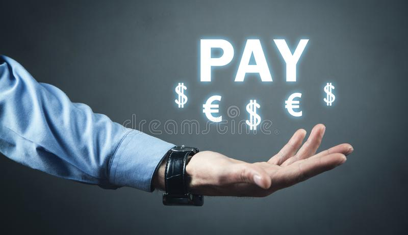 Man holding Pay text with a currency symbols stock image