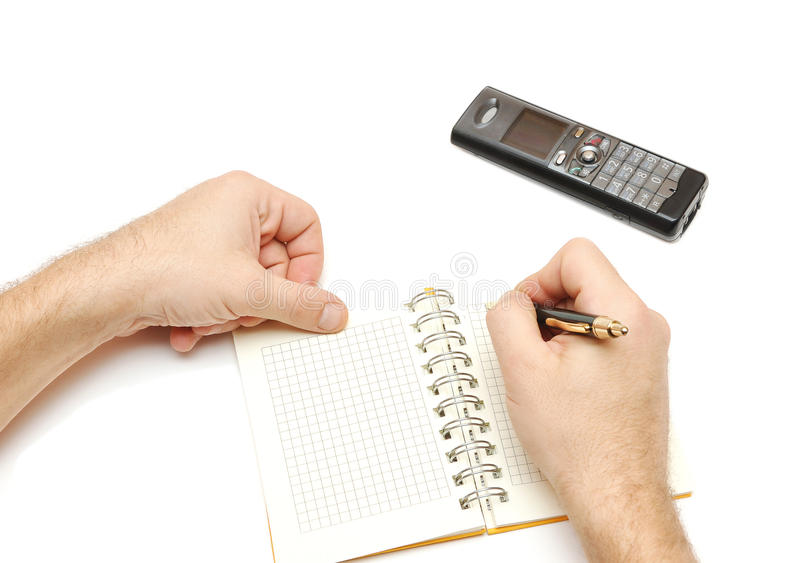 Man holding pen and writing in weekly planner, stock photography