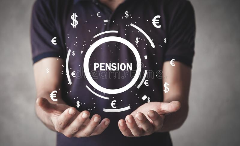 Man holding Pension word with a currency symbols royalty free stock images