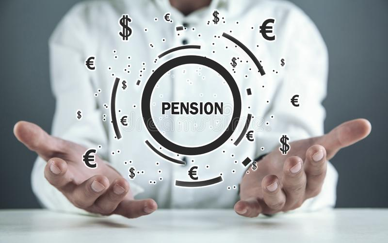 Man holding Pension word with a currency symbols royalty free stock photography