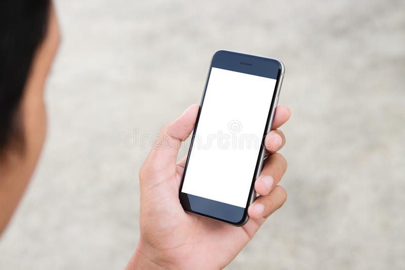 Man holding phone white screen royalty free stock photography