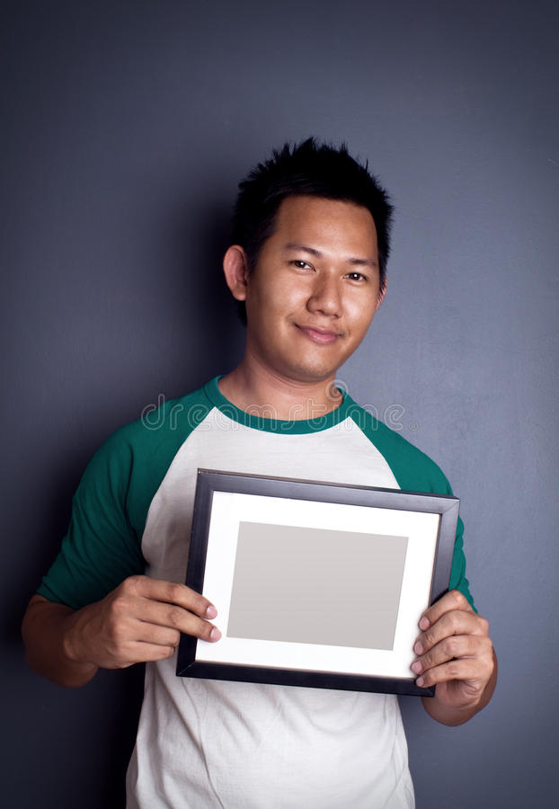 Man holding picture frame. Man holding blank picture frame stock photos