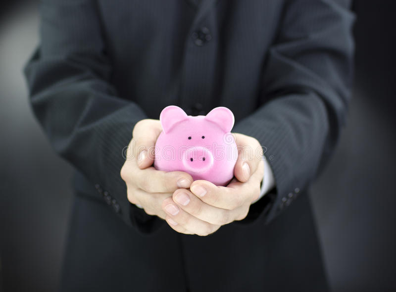 Download Man holding piggy bank stock image. Image of business - 15956063
