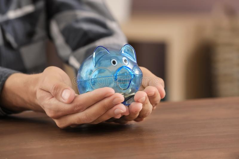 Man holding piggy bank in hands. Savings concept royalty free stock photo