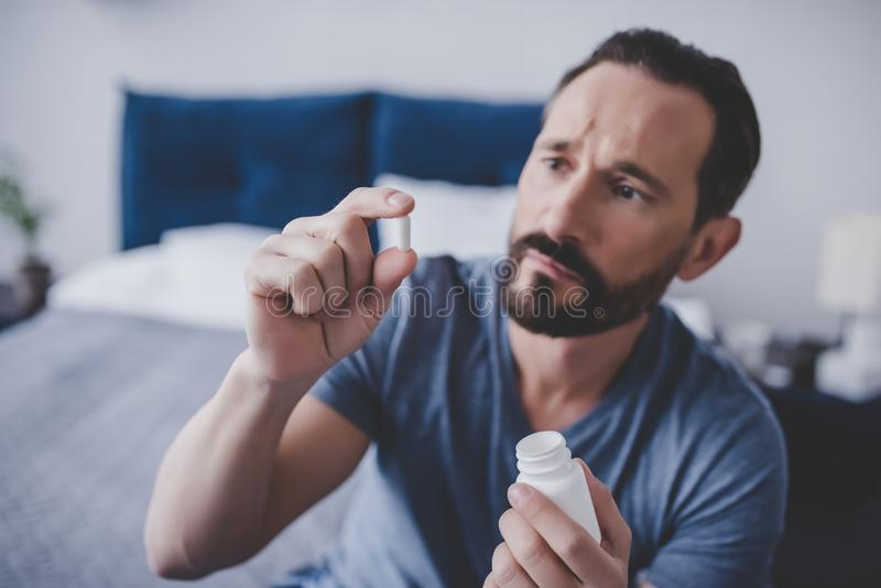 Man holding pill royalty free stock images