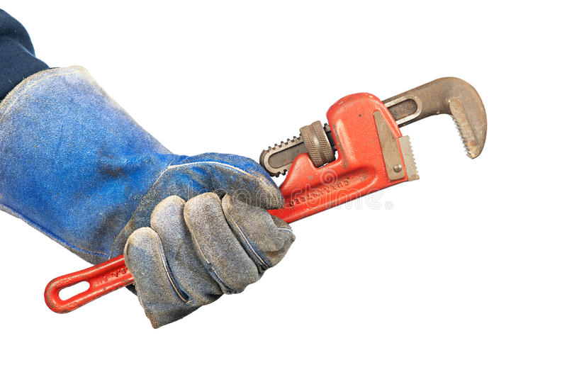 Man holding plumbers wrench royalty free stock image