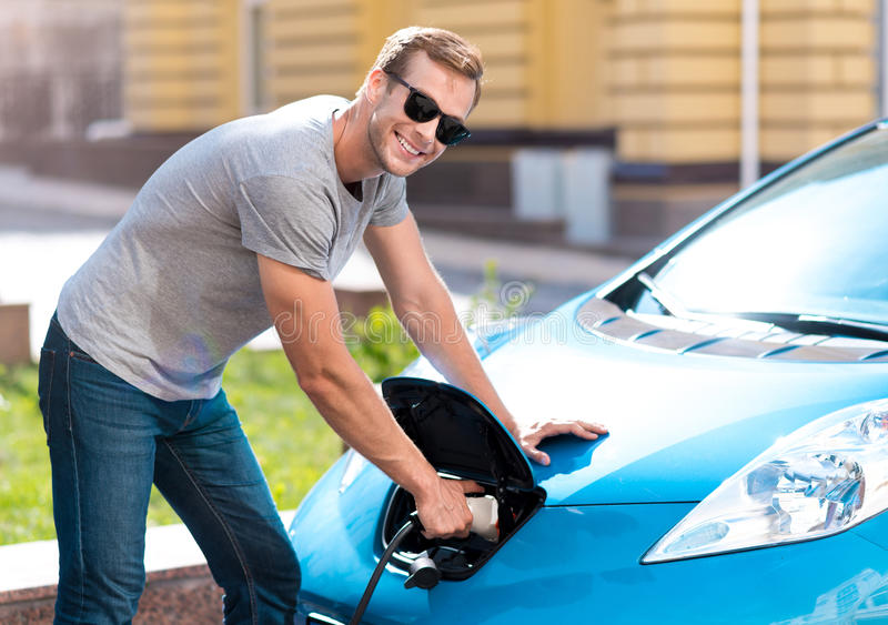 Download Man Holding A Power Connector For Car Stock Photo - Image: 74807262