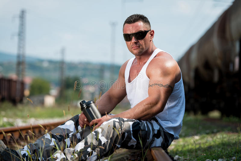 Download Man Holding Protein Bottle stock photo. Image of build - 34975106