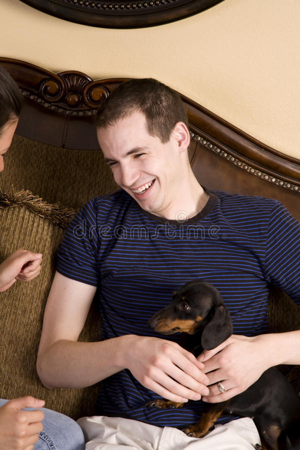 Man Holding Puppy Stock Image