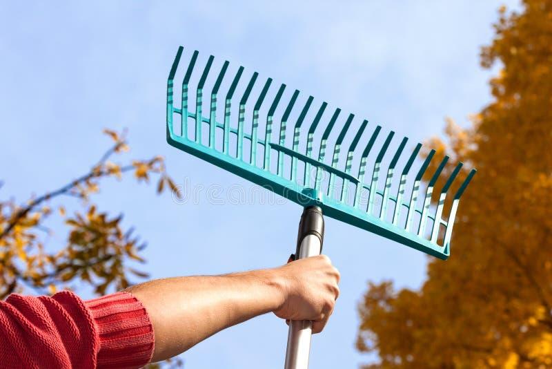 Man holding a rake stock photography