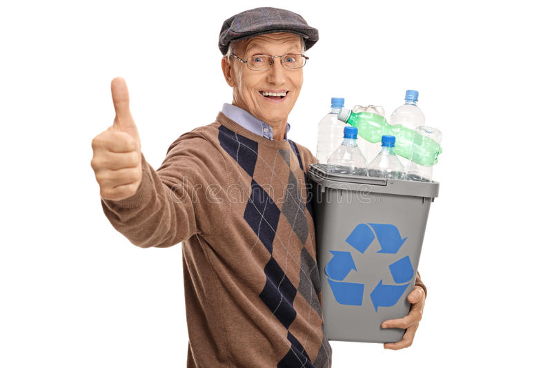 Man holding a recycling bin and giving a thumb up stock images