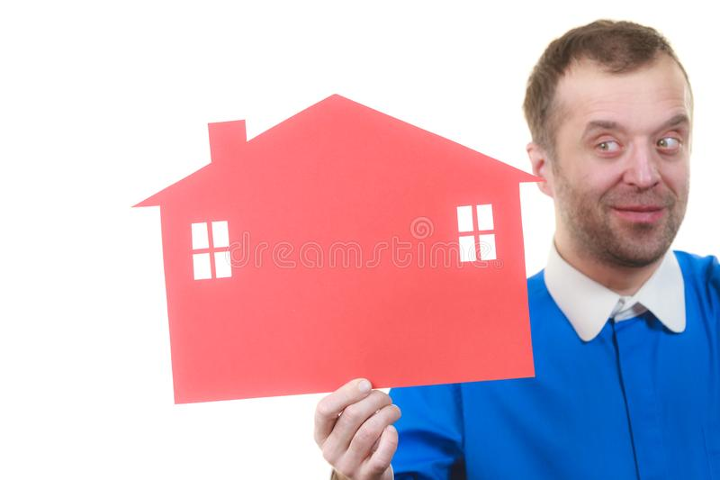 Man holding red house model. Man holding red conceptual house model. Real estate agent, home ownership concept stock images