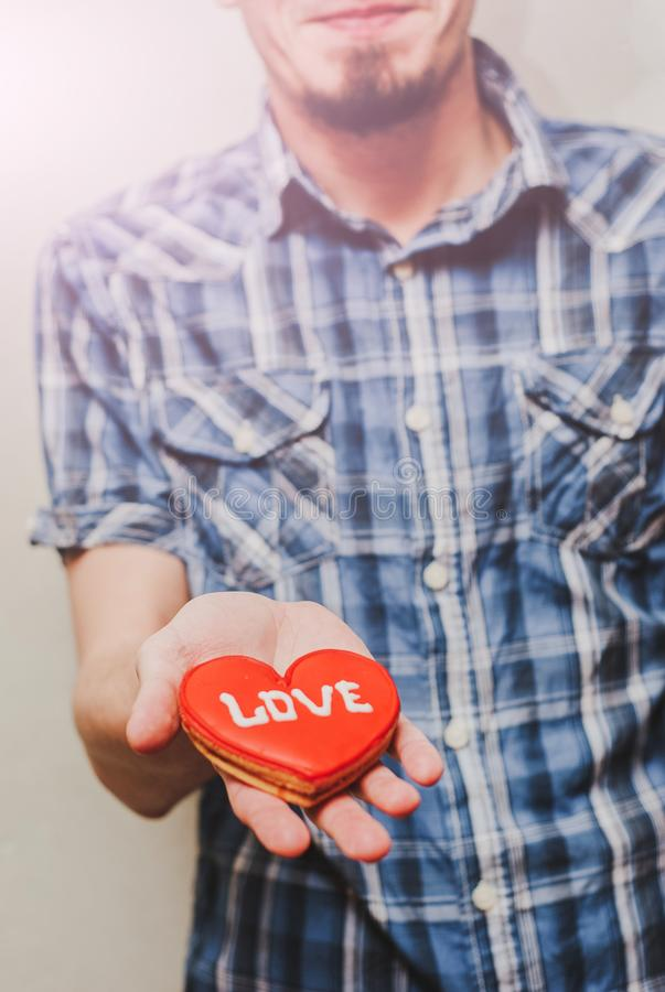 A Man holding a red heart symbol. valentine`s day concept. A Man holding a red heart symbol stock image