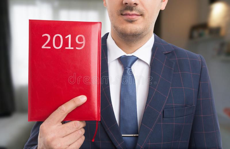 Man holding red notebook stock photos